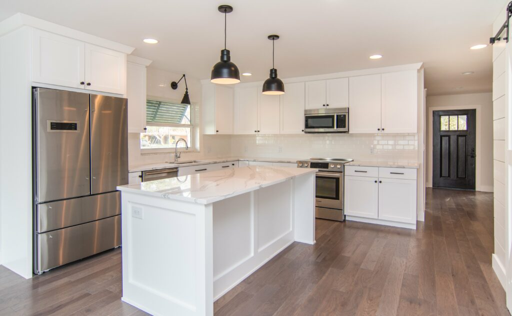 sun-bay-builders-546-rafael-blvd-ne-saint-print-008-13-kitchen-4200×2595-300dpi